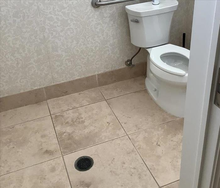 Commercial bathroom with tile floor