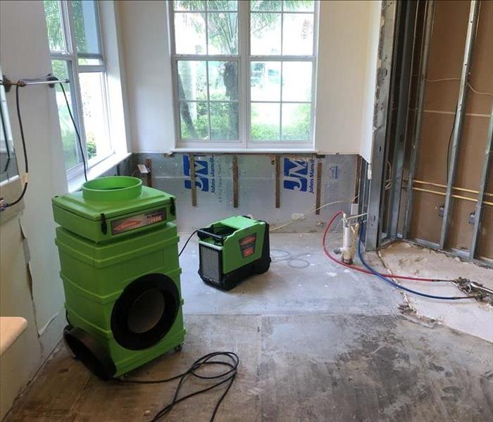 Bathroom with SERVPRO equipment