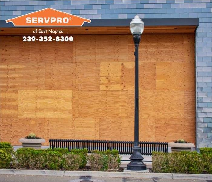 Commercial building covered with boards to prevent water damage or storm damage.