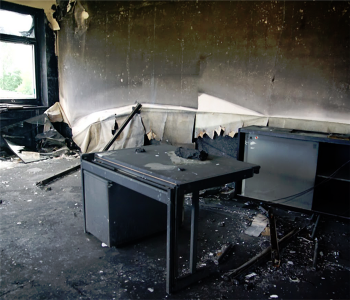 burned office room with desk in the middle